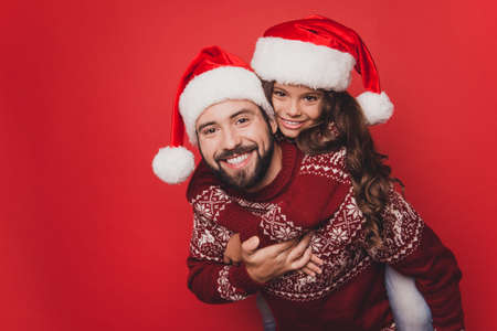 Close up of adorable sweet guy dad with small cute girl fooling around, excited in knitted cute traditional x mas costumes with ornament, head wear, december, noel time, freedom, celebrate, winter Фото со стока