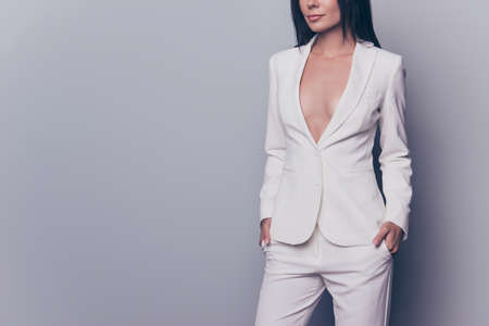 Cropped shot of hot gorgeous well dressed by formal dress code stunning charming business lady, standing on pure light background, with arms in pockets of classic pants Imagens