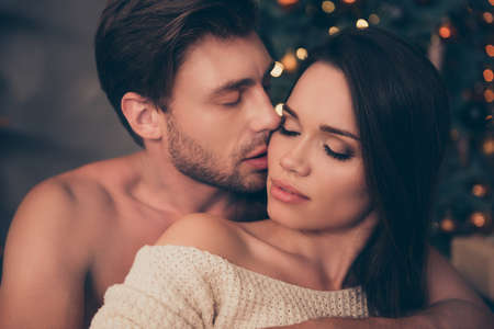 Closeup of brunet partner with bristle hold his brunette from back, cute feelings,  temptation pleasure, smooth skin, intense, tender, celebrate christmastime
