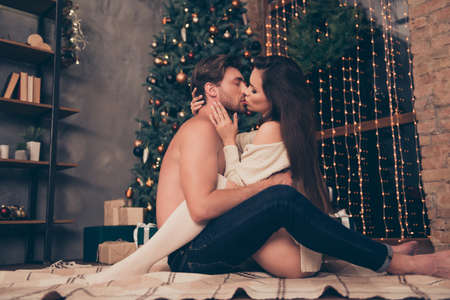 Side profile view of brunet partner with bristle hold cuddle sensual sexual his brunette lady, cute feelings, horny hot naughty passion, temptation pleasure, celebrate christmastime 스톡 콘텐츠