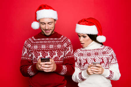 Curious secretive obsessed possessive controlling drama queen spies on lover`s smartphone, x mas costumes, head wear, isolated on pure background