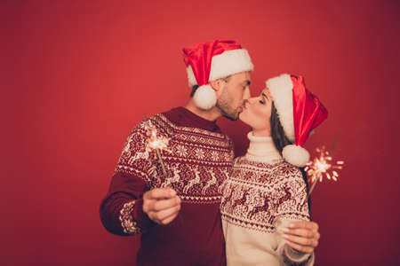 Adorable, lovely, sensual cute partners in knitted traditional x mas costumes with ornament hold sparkles and kiss, winter, noel, x mas miracle, holy spirit, true feelings