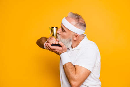 Side profile shot of emotional cool grandpa with reward, sign of respect, hero, strength, power. Body, health, care, lifestyle, game, coach, challenge, champ, fit, leisure, training, workout Stock Photo