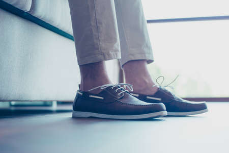 Portrait of legs with modern, fashionable mens shoes with shoelaces Stock Photo