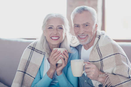 Excellent retirement! Close up portrait of happy delightful excited old people with toothy beaming smile, they are resting, relaxing, drinking tea and embracing