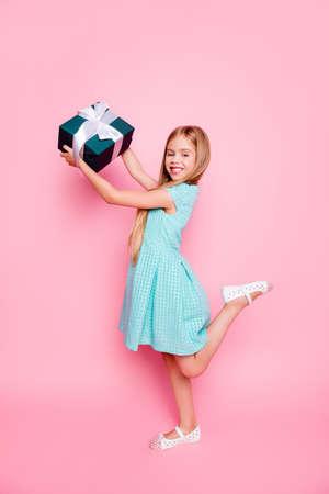 Vertical full-size full-length portrait of cute joyful positive beautiful girl having a birthday