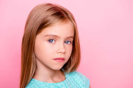 Close up portrait of cute nice lovely charming adorable beautiful confident concentrated little girl with big blue eyes