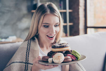Diet is finished! Wow! Yum-yum! beautiful excited happy glad joyful woman is going to eat sweets, donuts and macaroons at the weekend, she is alone and nobody sees her!