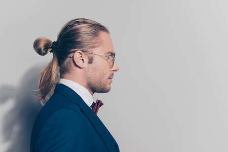 Half face close up portrait  bearded man in glasses with tail in formal outfit over grey background Stock Photo