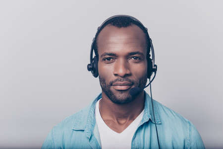 Close up portrait of confident cheerful professional smart clever intelligent with bristle stubble guy wearing casual clothing using headphones for working isolated on gray background Stock fotó