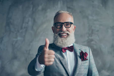 Well done! Portrait of cheerful man with beaming toothy smile sharp-dressed with burgundy handkerchief in pocket elegant stylish trendy recommending to visit barbershop isolated on concrete background