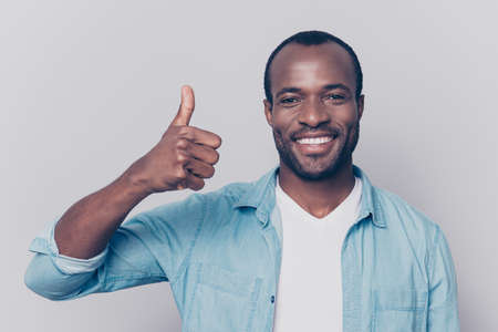 Hey there! Close up portrait of cheerful delightful excited handsome expert qualified impressed guy showing thumb-up isolated on gray background