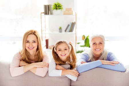 People femininity beauty comfort maternity concept. Sweet tender cute lovely adorable gentle beautiful careless cheerful joyful schoolgirl mom granny leaning on the back on sofa wearing casual clothes