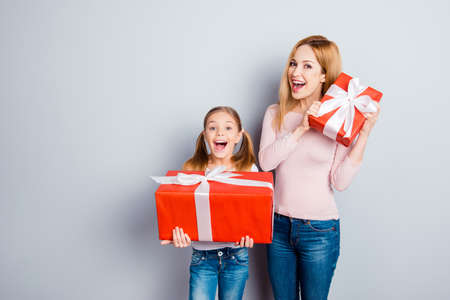 Feelings people day-off delight rejoicing sale discount pleasure miracle wonderment spring concept. Two astonished amazed shocked cute sweet curious mama and girl get boxed isolated on gray background