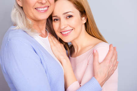 Close beloved darling mommy motherhood maternity warmth mom mum concept. Cropped close up photo portrait of hugging cuddling granny grandma peaceful beautiful granddaughter isolated on gray background