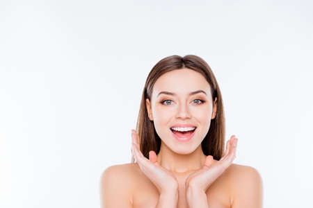 Wellness vitality sensitive concept. Close up portrait of excited attractive tender with soft smooth flawless ideal face after therapy holding hands near face isolated on white background copy-space