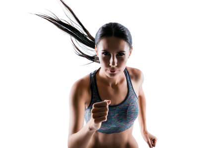 I see a purpose, but I dont see obstacles! Portrait of strong powerful attractive sporty focused confident woman with perfect body, she is running fast, isolated on white background