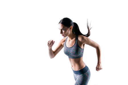 I am leader and number one! Concept of being best of the best! Side profile view portrait of strong beautiful sporty muscular woman she is running to finish line isolated on white background