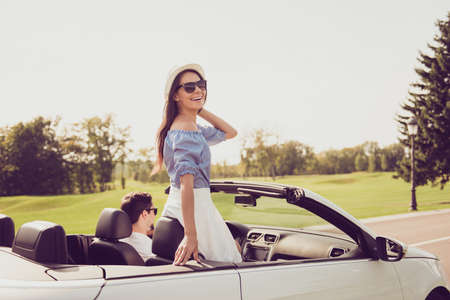 Inspiration, happiness, destination relax, trip, vehicle rent, honeymoon relationship, friends, speed ride lifestyle. Beautiful cheerful lady in dress express vitality, emotions, success euphoria