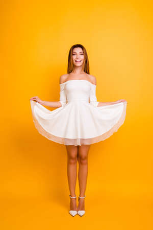 Bride birthday stylish modern model 14-february skinny body shape figure people person concept. Vertical full-size full-length portrait of lovely lady holding bottom of dress isolated background