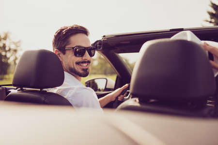 Bachelor single masculine lifestyle, happiness, enjoy escape, reach destination. Close up cropped back rear view shot of carefree successful romantic dreamy well dressed stylish driver in specs Stockfoto