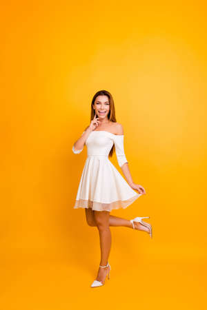 Vertical full-size full-length front view portrait of attractive charming beautiful carefree tender gentle pretty bride, short cocktail dress with naked shoulders and stilettos isolated on background