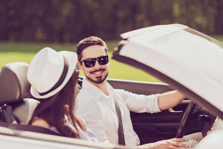 Feelings, married family, friendship, reach destination, escape, speed ride lifestyle. Carefree cheerful driver husband, lady wife are on their way to dreams and happiness, nice route Stockfoto
