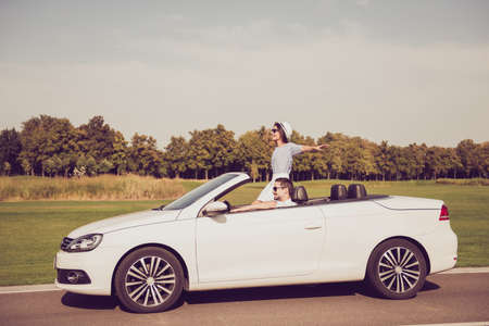 Happiness, inspiration, destination relax, trip, vehicle rent, honeymoon relationship, friends, road escape, speed ride lifestyle. Beautiful cheerful lady in dress express success, euphoria, fly