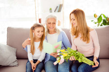 Handmade poem pleasure looking draw picture heart freshness concept. Friendly cute kind cheerful excited delightful adorable sweet cute tender gentle family members reading greeting from card on sofa