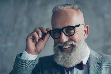 Close up portrait of cheerful affable stylish trendy rich intelligent smart dreamy professional elegant excited elite luxurious old-fashioned grandpa