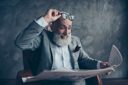 Attractive, laughing boss in suit take off glasses, look, watch, read conical facts, information in newspaper
