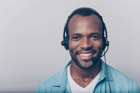 Close up portrait of cheerful positive smart clever friendly guy wearing casual clothing using headphones