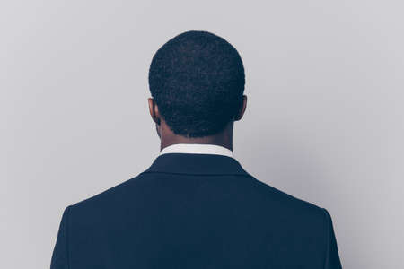 Rear, back side view portrait, snap shot of attractive, trendy man with modern haircut Stock Photo