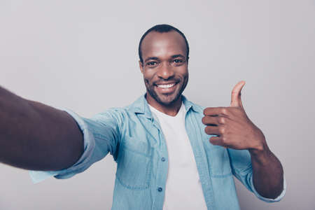 Close up portrait of cheerful excited satisfied glad confident guy wearing jeans casual shirt