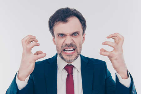 Close up portrait of aggressive terrifying frightening demonstrating teeth gesturing with hands boss wearing red tie dark blue jacket isolated on gray background