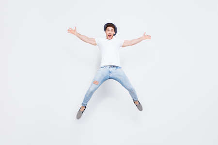Full-length full-size portrait of crazy mad excited cheerful lucky leader dreamy handsome fashionable man jumping up like a star isolated on gray background Reklamní fotografie