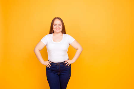 Portrait of happy excited cheerful confident with beaming toothy smile fatty woman wearing white tshirt and jeans