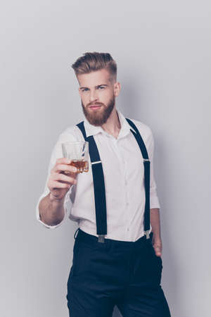 Vertical portrait of stylish virile masculine sexy flirty brutal groomed attractive handsome focused confident cool classy posh strict restrained guy keeping hand in pocket isolated on gray background