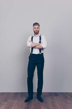 Vertical full-length full-size portrait of brutal handsome strict proud harsh authoritative bossy serious man standing with crossed arms wearing formal clothes outfit isolated on gray background Stock Photo