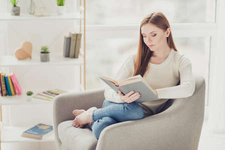 Fun free-time highschool people person hipster interior warm casual emotion expressing intelligence alone domestic knowledge concept. Beautiful cute tender calm girl reading novel in a living room