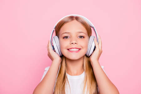Style playlist leisure lifestyle weekend positive glamour concept. Close up portrait of cute lovely sweet tender adorable girl listening to favorite song using headphones isolate don pink background Stock Photo