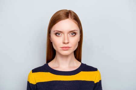 Close up portrait of pretty beautiful attractive cute lovely sweet tender focused serious gentle with straight long red hair woman wearing yellow black pullover isolated on gray background copy-space Stock Photo
