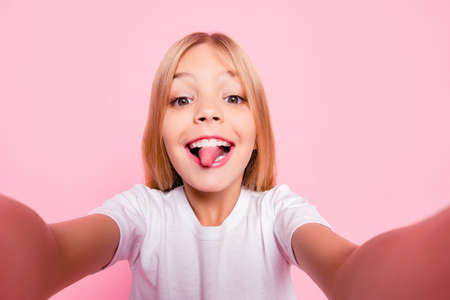 Style play stylish trend glamorous toothy fun-time comedian humor tongue-out concept. Close up portrait of sweet cute lovely adorable carefree playful girl taking selfie isolated on pink background