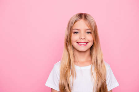 Education healthcare school life concept. Close up portrait of sweet charming beautiful lovely calm with toothy beaming smile small girl with straight smooth hair isolated pink background copy-space