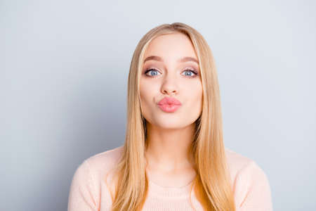 Enjoy lifestyle thankful people person concept. Close up portrait of adorable cute lovely sweet tender gentle beautiful with long hairstyle girl giving a kiss to you camera isolated gray background