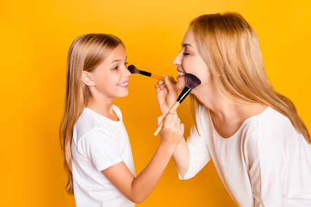 Two people relatives joy having fun enjoy dermatology spend time artist hairstyle concept. Profile side view photo of cute lovely beautiful charming nice friendly mom mum mommy kid doing makeup