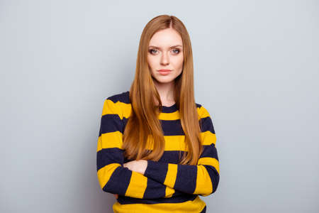 Portrait of cute lovely serious charming romantic pensive beautiful attractive with long healthy nice straight hair perfect ideal face features cheekbones isolated on gray background copy-space Stock Photo