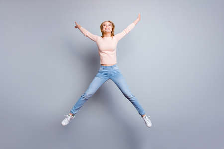 Trendy holiday vacation carefree leisure people pass exams person fall concept. Full-size view of excited careless delightful beautiful charming active teenage girl jumping up isolated gray background