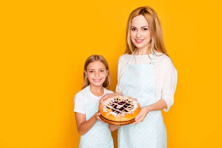 Upbringing blonde generation two self-made concept. Portrait of lovely charming beautiful cute tender gentle mom and kid holding in hands pie with jam powdered sugar isolated background