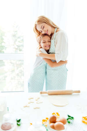 Pastry sweets holiday birthday surprise comfort coziness enjoy domestic delight peace concept. Vertical photo of cute lovely adorable girl cuddling to beautiful calm kind friendly mommy in light room Stock Photo
